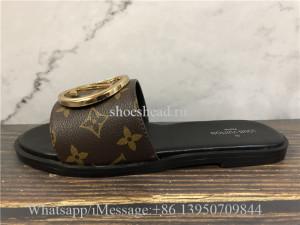 Louis Vuitton Monogram Lock It Flat Mule Slide