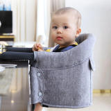 baby sits on a hook on high chair