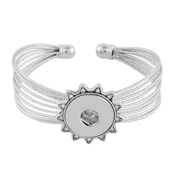 Los botones 1 ajustan el brazalete de metal con diamantes de imitación en forma de pedazos ajustables