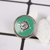 snaps metal chunks with clear rhinestones and green Enamel