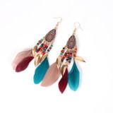 Boucles d'oreilles plumes style pendentif feuille nationale