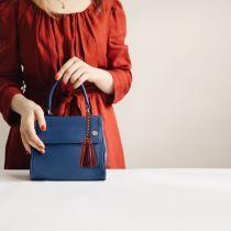 MOQ10 Remache taladro caliente borla caja del teléfono móvil accesorios colgantes nueva marca de moda diosa PU accesorios de borla de cuero La longitud total es de 6 cm