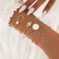 Elegante temperamento blanco goteando aceite imitación en forma de perla hueco redondo pulsera de cristal artificial conjunto de 6 piezas