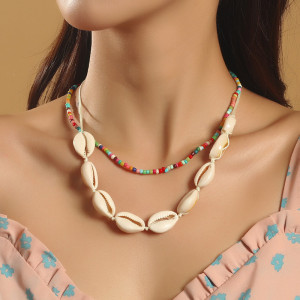 Collier multicouche de coquille de perle de riz fait à la main Europe et Amérique bijoux pendentif tissé