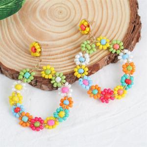 Boucles d'oreilles bohème géométrique ronde à la main fleur de riz boucles d'oreilles personnalité créative boucles d'oreilles tissées