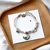 Shells, stars, moons and butterflies braided bracelet