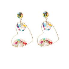 Boucles d'oreilles de mode dames perles de riz tissées à la main pure boucles d'oreilles d'amour de perles