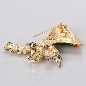 Christmas brooch with angel blowing trumpet