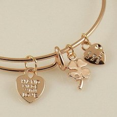 A wire bracelet with one big metal charms mother