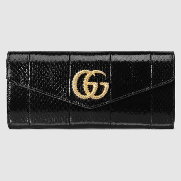 Broadway snakeskin clutch with Double G