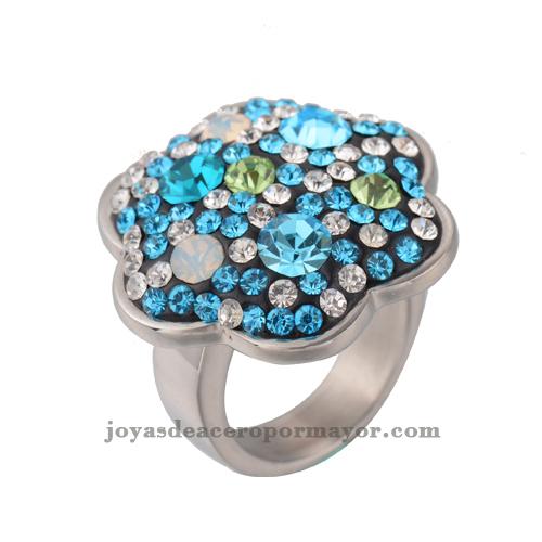 anillos plateado del lado arriba con una flor y encima de cristal de acero inoxidable