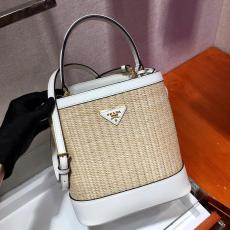1BA212 Prada ladies saffiano pure-hand-made grass-woven bucket bag graceful basket bag gold hardware