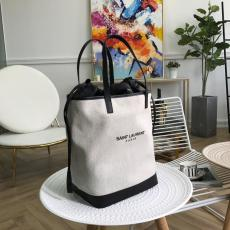 Yves Saint laurent/YSL waterproof canvas portable drawstring bucket bag lightweight shopping shoulder bag accompanied with delicate zipper clutch