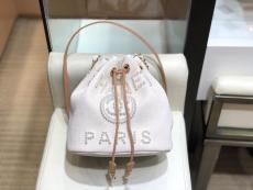 Chanel  57536 female tide canvas tassel drawstring bucket bag
