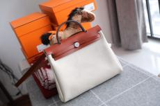 Hermes herbag 31 canvas  waterproof handbag contrast-color holiday traveling bag amply internal space for daily essentials