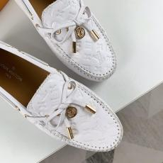 Louis vuitton/LV female monogram-embossed flat loafer casual slip-on driver shoe with adorned bowknot and house signature charm