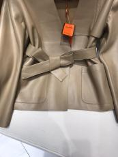 Hermes female open-front collarless leather jacket minimalist leather trench coat winter outwear windbreaker with pair of symmetrical slip pocket and waisted belt