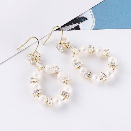 New European Exaggerated Hollow Bow Pearl Earrings Female Cool Temperament Circle Zircon Earrings Wholesale 138713