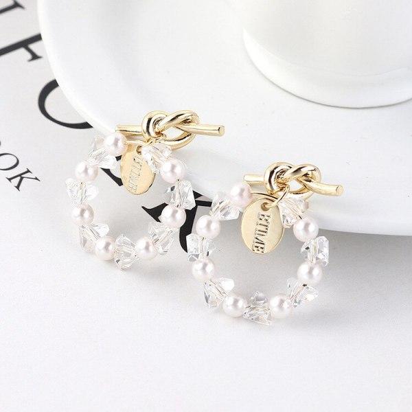 Korean Fashion Cool Knotted Stud Earrings Women's Simple Seal Ring Imitation Pearl Earrings S925 Silver Needle Earrings 138935