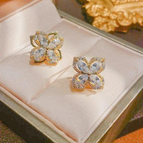 Sterling Silver Needle Rotating Four-Leaf Flower Stud Earrings Micro Inlaid Zircon Temperament Wild Flower Earrings
