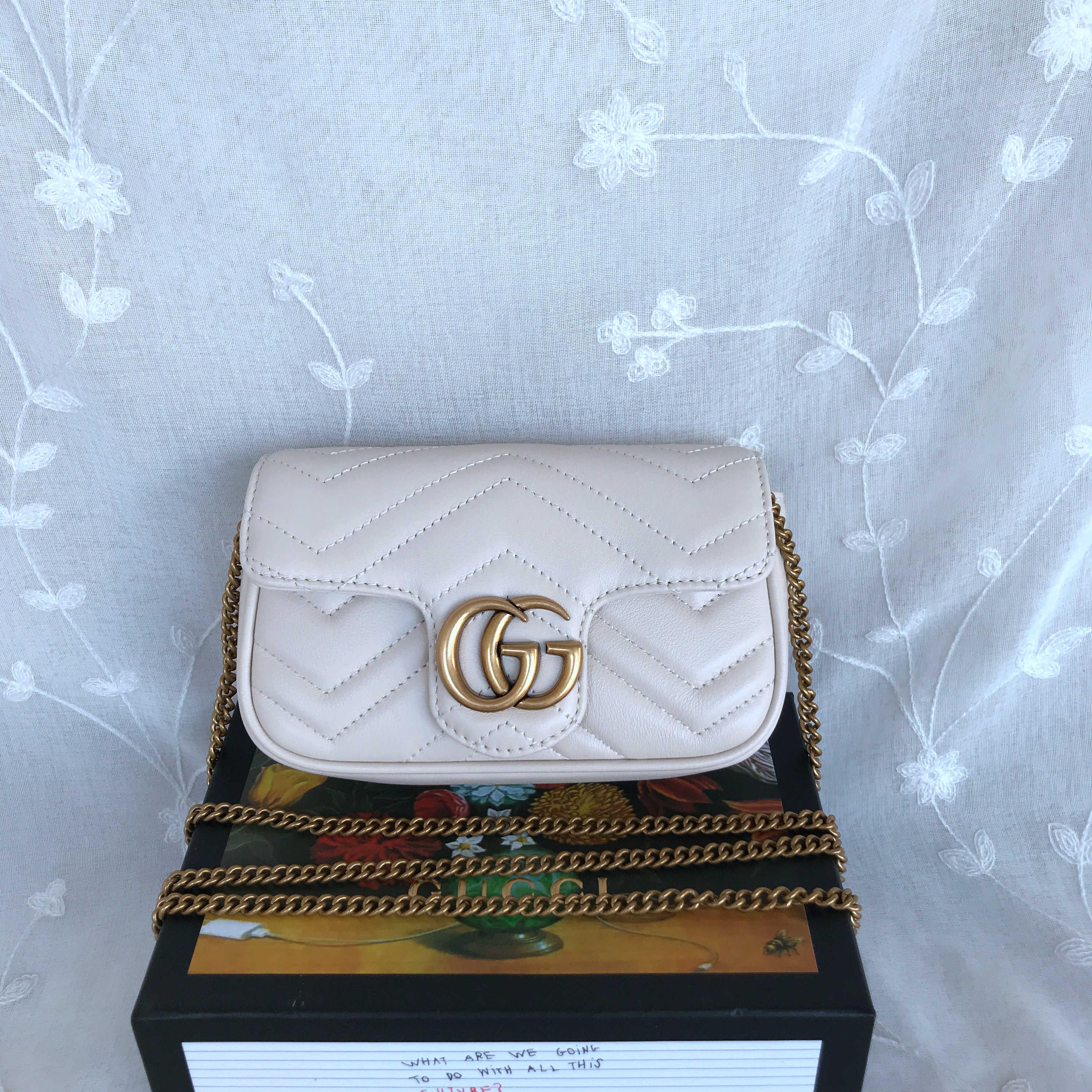 Gucci Marmont Matelasse leather super mini bag 476433