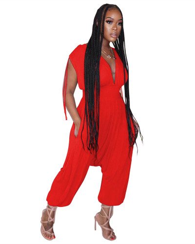 Red Solid color waist deep V loose jumpsuit