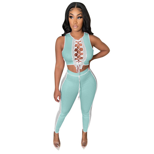 Ligtht bule Contrasting color pit strip stitching mesh bandage hollow casual suit