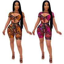 Summer Women Clothing Sexy Print Lace Up Hollow Out Short Sleeve Clubwear Bodycon Rompers NK-8610