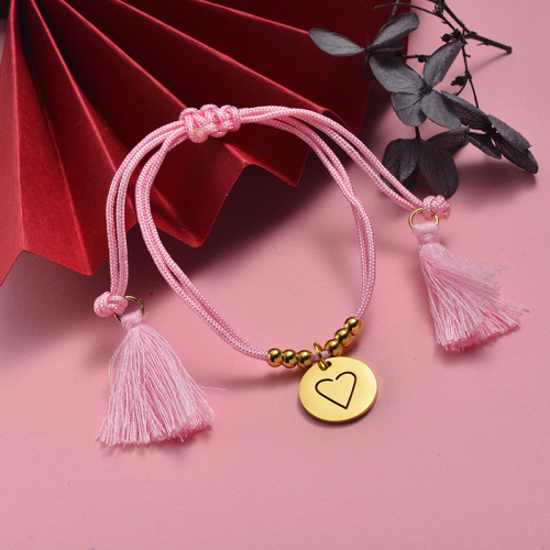 Pulsera ajustable de cuerda rosa tejida a mano con colgante redondo de acero inoxidable dorado
