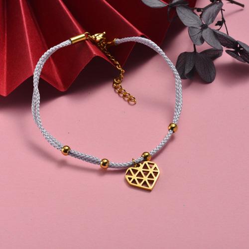 Pulsera de cuerda blanca tejida a mano con colgante en forma de corazón hueco de acero inoxidable dorado