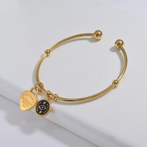 Bracelet en acier inoxydable doré de style simple avec pendentif noir dégoulinant de mauvais œil