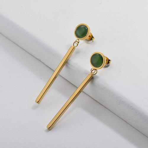 Boucles d'oreilles pendantes en or avec pierre émeraude