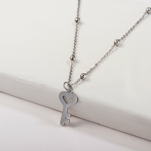 Collier pendentif clé en acier inoxydable argenté simple pour femme
