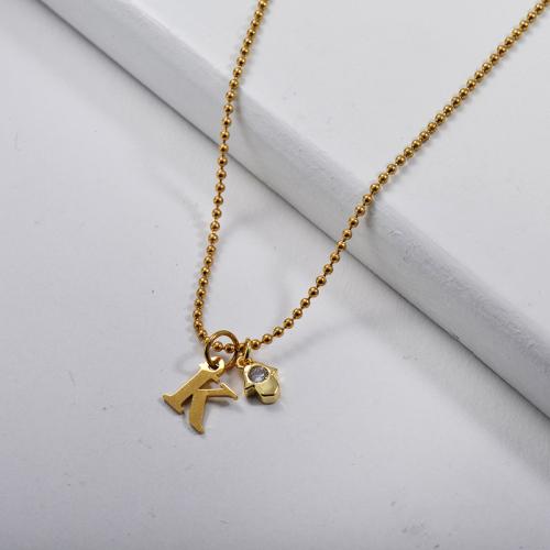 Collar con dije de cobre y letra K de oro simple con mano de Hamsa