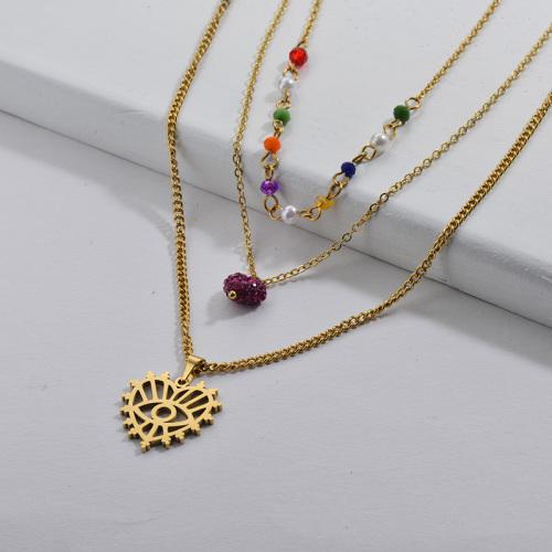 Collar de múltiples capas de perlas de colores con patrón de ojo malvado de corazón hueco dorado de moda para mujer
