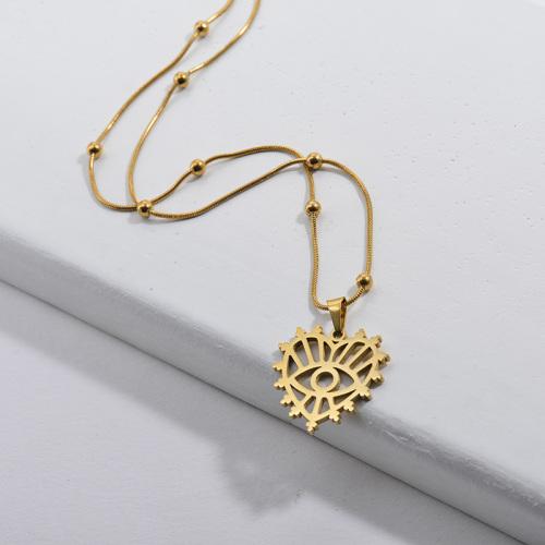 Corazón hueco de oro de moda con collar de cadena de bola colgante con patrón de mal de ojo