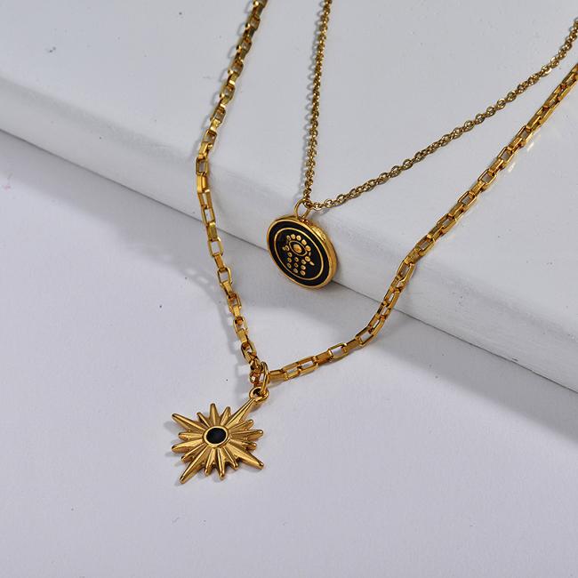 Collar de capa de mano de Hamsa de esmalte negro chapado en oro con colgante de estrella