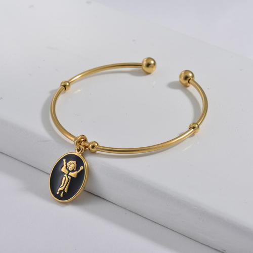 Bracelet en acier inoxydable doré de style simple avec pendentif goutte d'huile noire
