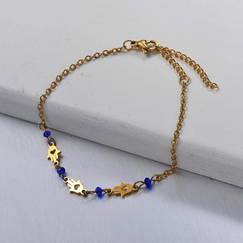 Pulsera separada de palma de acero inoxidable y cuentas de cristal azul