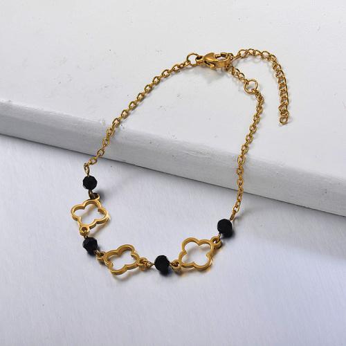Trébol de cuatro hojas hueco de acero inoxidable dorado y brazalete divisor de cuentas de cristal negro