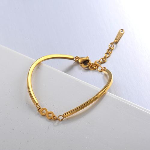 Elegante y simple brazalete abierto de acero inoxidable dorado con colgante en forma de 8
