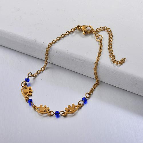 Pulsera con ojos dorados de acero inoxidable y cuentas de cristal azul