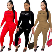 Fashion leisure autumn and winter models solid color letter offset printing round neck slim sports two-piece suit SM9118