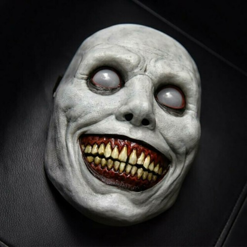 Creepy Halloween Smiling Demon Face