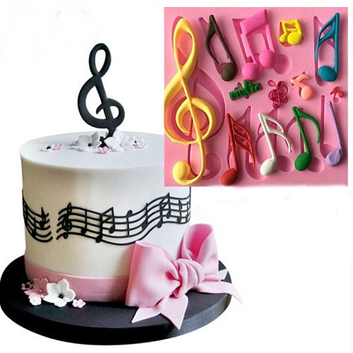 Silicone Cake molds in various musical note shapes  Chocolate chip cookie pans Fudge tools Baking utensils