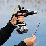 New Fishing Set Slingshot Hunting Catapult Suit Outdoor Shooting Fishing Reel + Darts Protective Gloves Flashlight Tools