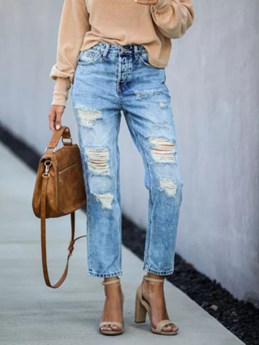 New jeans with holes of street hipsters and straight leg pants