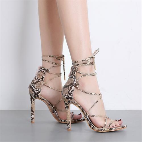 Serpentine high heel open toe sandals
