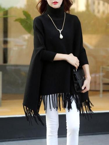 Asymmetrical Batwing Turtle Neck Fringed Solid Poncho