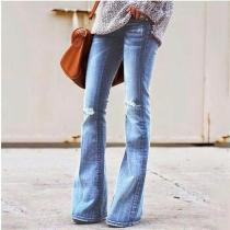 Women's casual hole slimming hip jeans